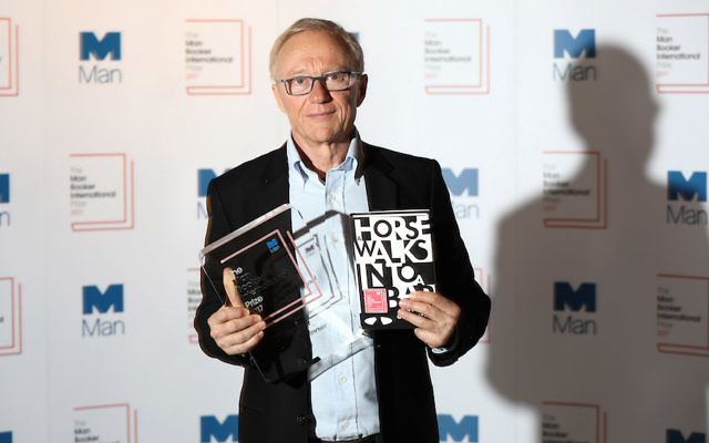 "David Grossman posing after being announced as the winner of the Man Booker International Prize 2017 for his book ""A Horse Walks into a Bar"" at Victoria & Albert Museum in London, June 14, 2017. (Tim P. Whitby/Getty Images)"