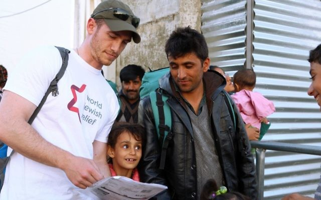 A volunteer with the organization World Jewish Relief works with refugees in Greece. (Minos Alchanati)