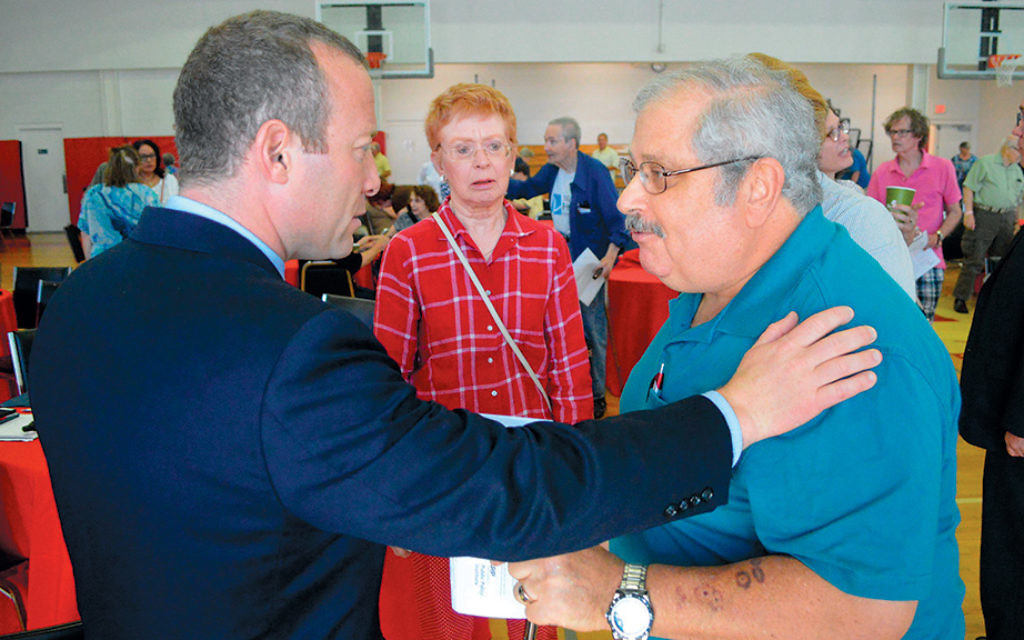 Josh Gottheimer talks to constituents at an AARP meeting in Fair Lawn in June.