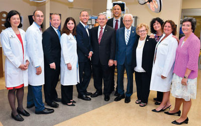 Hospital administrators, medical professionals, and politicians gathered for a press conference at Englewood Hospital and Medical Center; from left, they are Judy Wong, Jeffrey Gudin, Josh Gottheimer, Hillary Cohen, Warren Geller, Bob Menendez, Cory Booker, Bill Pascrell, Loretta Weinberg, Rosemarie Hill, Terry Bertolotti, and Betsy Ryan. (Englewood Hospital and Medical Center)