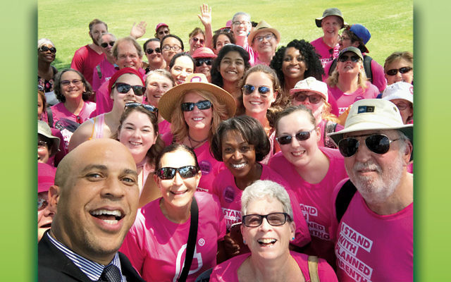 Senator Cory Booker, front left, joins a delegation of New Jersey residents in Washington to support Planned Parenthood.
