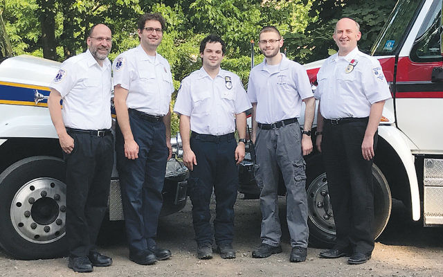 The leaders of two local ambulance corps — the Teaneck and Bergenfield Volunteer Ambulance Corps — from left, are Rabbi Daniel Senter, Dr. Eliyahu Cooper, and Izzy Infield, respectively president, medical director, and captain of the TVAC, and Mordechai Farkas and Ryan Shell, respectively lieutenant and captain of the BVAC.
