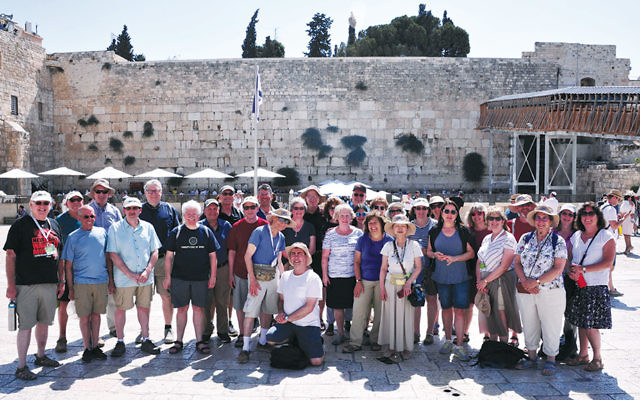 Members of the tour group gather in front of the Kotel in Jerusalem. (Barbara Balkin)
