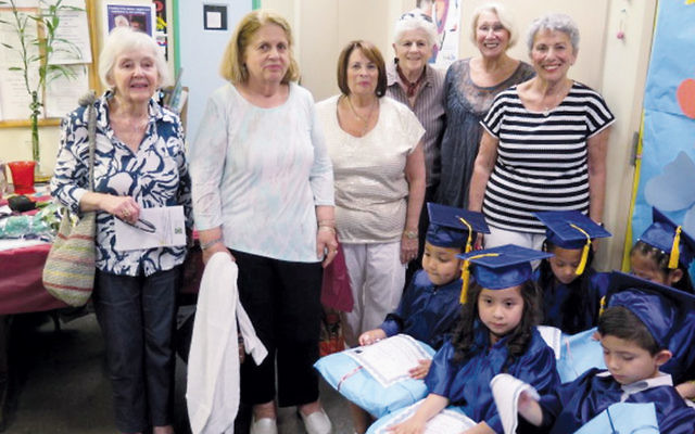 National Council of Jewish Women volunteers look on at the new graduates of Bergen Family Center's HIPPY program. (Courtesy NCJWBCS)