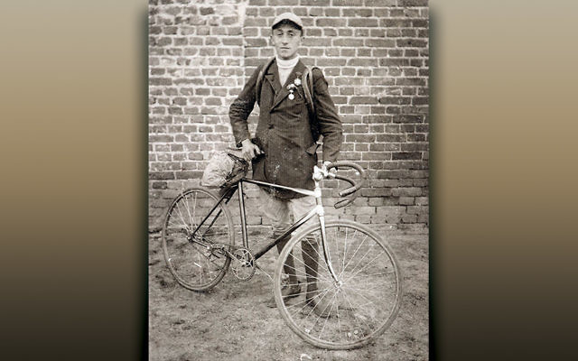 Moshe Cukierman, a member of the Bar Kochba sports club in Lodz, Poland, beside his bicycle, early 1920s. (From the Yad Vashem online exhibition)