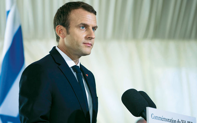 Emmanuel Macron speaks at the July 16 ceremony commemorating the 75th anniversary of the Vel d'Hiv Holocaust roundup in Paris. (Kamil ZihnIoglu/AFP/Getty Images)