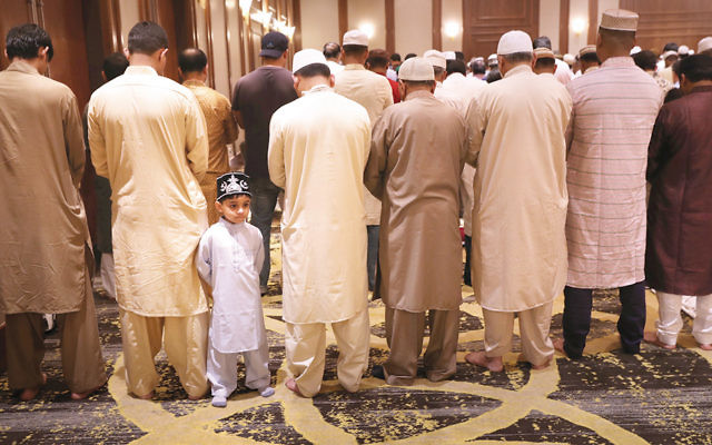 Muslim men at a prayer service celebrating Eid-al-Fitr in Stamford, Conn., last month. (John Moore/Getty Images)