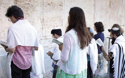 Conservative Jews pray at Robinson's Arch in Jerusalem on July 30, 2014. (Robert Swift/Flash90)