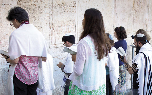 Conservative Jews pray at Robinson's Arch in Jerusalem on July 30, 2014. (Robert Swift/Flash90)