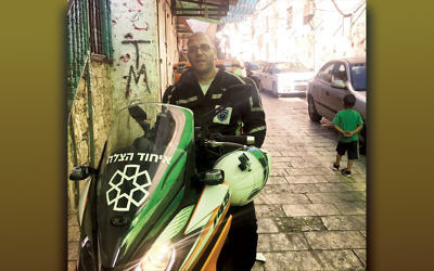 Nedal Sader sits on his United Hatzalah motor scooter in the Old City of Jerusalem on July 14. (Andrew Tobin)