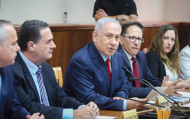 Israeli Prime Minister Benjamin Netanyahu, center, leading the weekly Cabinet meeting in Jerusalem on June 25. (Marc Israel Sellem/Pool/Flash90)