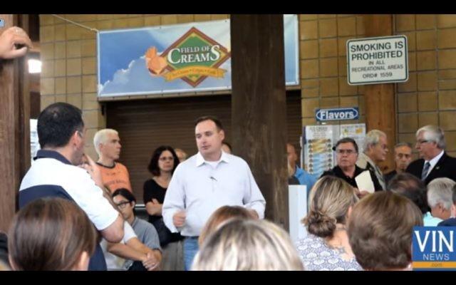 Mahwah resident Robert Ferguson addresses a gathering discussing the eruv on Monday. (VosIsNeis.com)