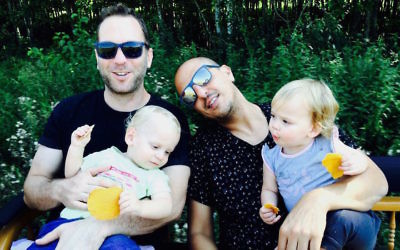 Ohad Hitman, left, and partner Ran Hurash with their twins Berry, left, and Eva. (Courtesy of Hitman)