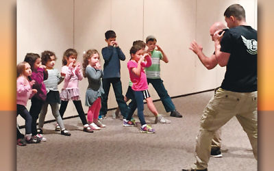 Young students at NNJJA are introduced to Krav Maga, the self-defense system developed for the Israel Defense Forces.
