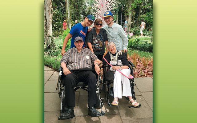 Banji Ganchrow, flanked by her sons Matthew and Jonah, stands with her parents, Richard and Eita Latkin, in the New York Botanical Gardens.