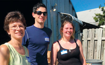 Volunteers with the Center for Food Action arrive at a distribution site.
