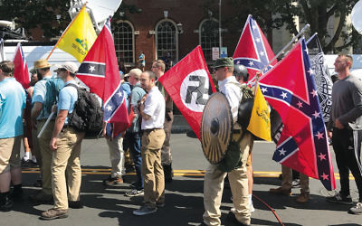 White supremacist protesters carry Nazi and Confederate flags in Charlottesville, Va., on August 12.  (Anthony Crider via Wikimedia Commons)