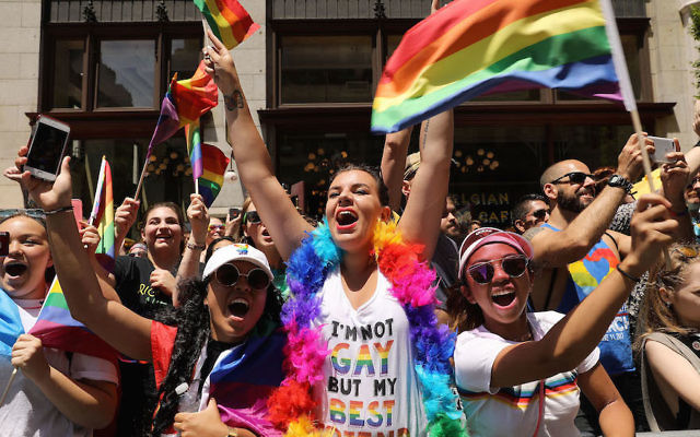 People cheering at the annual New York Gay Pride Parade, June 25, 2017. (Spencer Platt/Getty Images)
