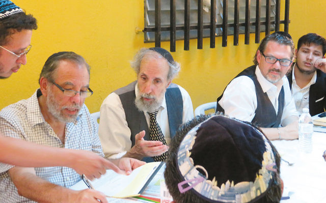 From left, Moshe Omar Cohen-Henriquez speaks with beit din members Rabbi Mark Kunis, Rabbi Andy Eichenholz, and Rabbi Marc Phillipe in Managua, Nicaragua, on July 20. On the far right is Even Centeno, a convert who traces his ancestry to Sephardic Jews who were forced to convert to Christianity.