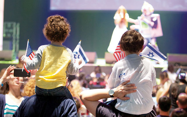 Children wave Israeli and American flags at the Celebrate Israel parade in Manhattan on June 4. (Perry Bindelglass)