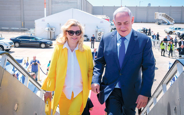Israeli Prime Minister Benjamin Netanyahu and his wife, Sara, on their way to Greece for a two-day state official visit in June. (Amos Ben Gershom/Israeli Government Press Office/Flash90)