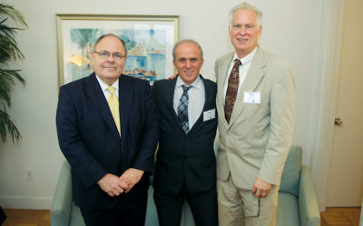 From left, the Consul General of Israel in New York, Dani Dayan, the Weizmann Institute's Dr. Yosef Yarden and the president of the Israel Cancer Research Fund, Rob Densen, at the consul general's home. (Perry Bindelglass)