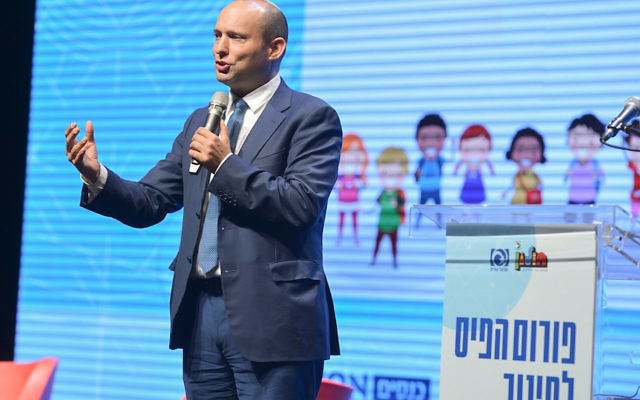 Israeli Education Minister Naftali Bennett speaking at an education conference in Holon, Israeal, Aug. 30, 2017. (Avi Dishi/Flash90)