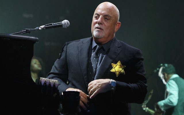 Billy Joel wearing a yellow Star of David during the encore of a show at Madison Square Garden in New York City, Aug. 21, 2017. (Myrna M. Suarez/Getty Images)