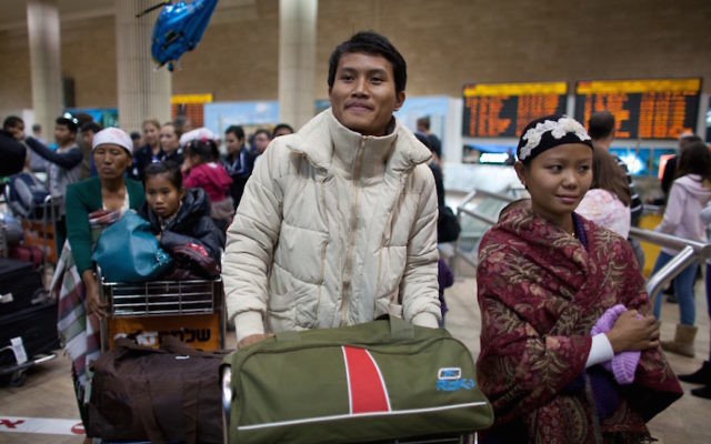 Members of the Indian Bnei Menashe community, whose members claim ancestry from one of the lost tribes of Israel, arriving at Ben Gurion Airport in Israel, Dec. 24, 2012. (Uriel Sinai/Getty Images)
