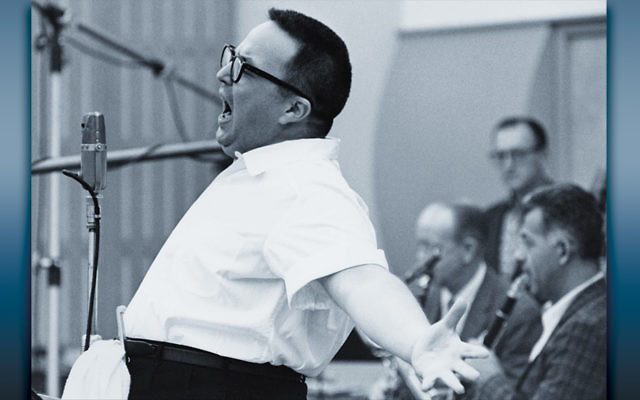 Allan Sherman belting out one of his musical parodies during a recording session.