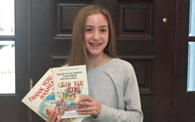 Sara Mirwis of Teaneck holds some of the books she has collected for young victims of Hurricane Harvey in Houston.