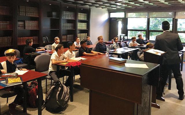 Sephardic cultural program director Rabbi Mordy Kuessous teaches students in the Sephardic Beit Midrash.