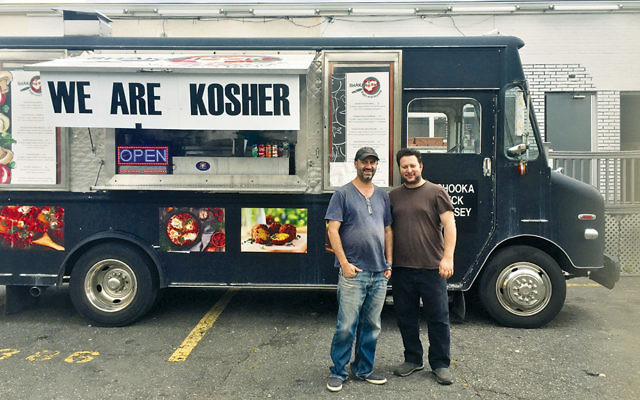 Boaz Nuriel, left, and Yuval Granevitz stand by their food truck.