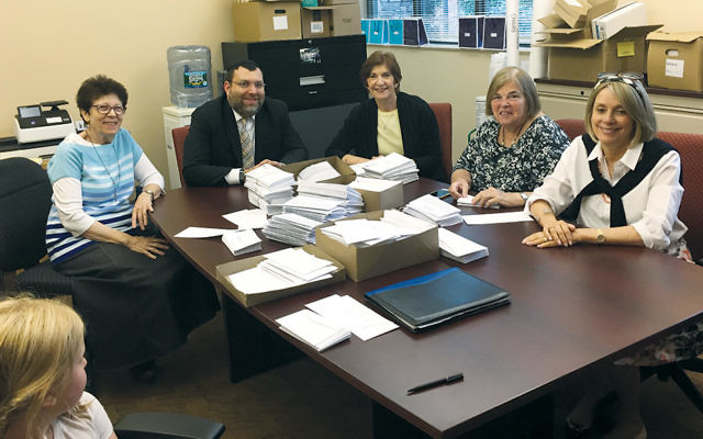 The Dor L'Dor committee includes, from left, Ellen Flamholz, Rabbi Chaim Poupko, Esther Fruchter, Beryl Neiwood, and Ruth Schapira. Deborah Berger and Diane Katzentstein-Feintuch are on the committee but not pictured.