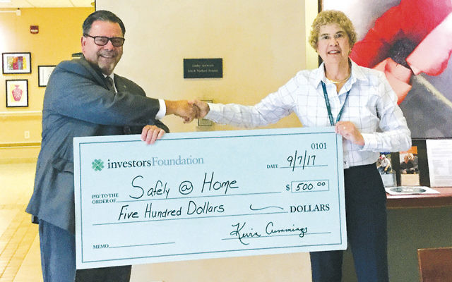 Neil B. Conlan, branch manager of Investors Bank in Nutley, left, with Stacey Orden, Safely@Home's director. (Jewish Home Family)