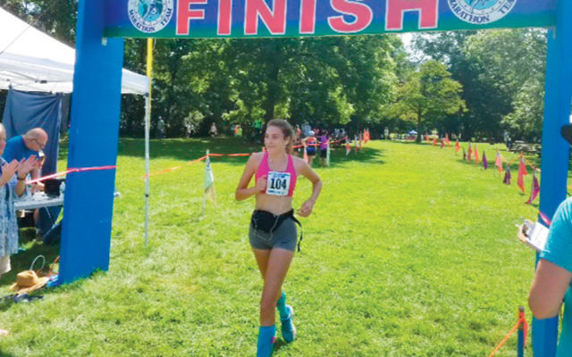 Elaine Martz crosses the finish line. (Noah Martz)