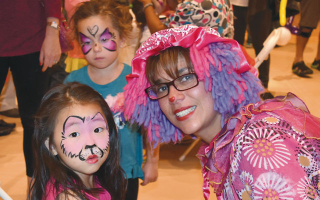 Children enjoy face-painting at the JCC's open house. (Courtesy JCCOTP)