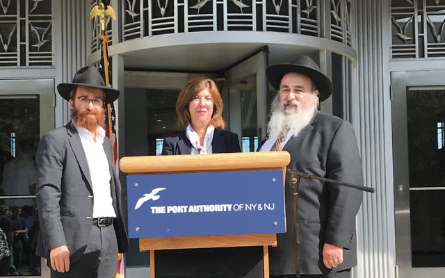 Rabbi Avremy Kanelsky, Bris Avrohom's Torah education and youth director and the manager of Newark Airport's Jewish information stand, Diane Papaianni, Newark International's general manager, and Rabbi Mordechai Kanelsky, BA's executive director.