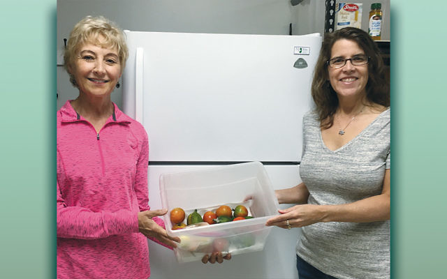 Volunteers at the Wayne Interfaith Network Food Pantry stand in front of the new refrigerator donated by P.C. Richard & Son of Wayne. (Courtesy WIN)