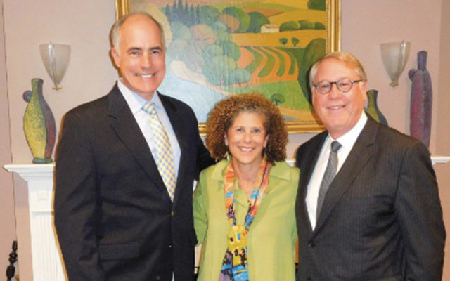 Senator Bob Casey, left, and Janet and Ken Hoffman. (Courtesy Norpac)