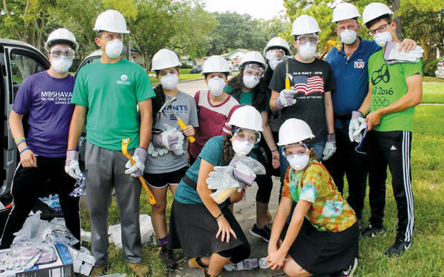 Volunteers from NCSY don protective gear at the United Orthodox Synagogue of Houston. (Photos provided)