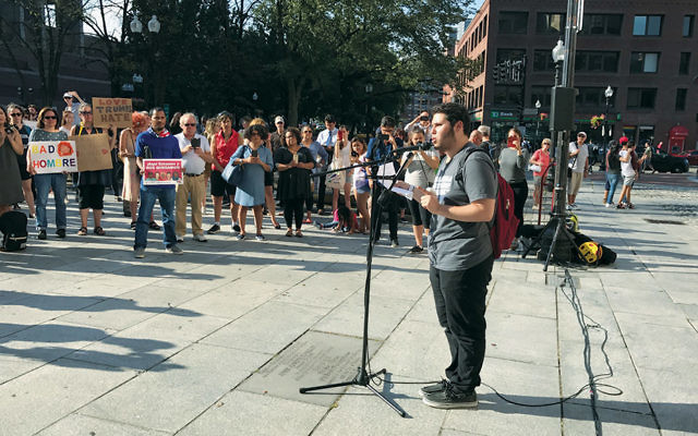 Elias Rosenfeld, a sophomore at Brandeis University, speaks at a rally at Boston's Faneuil Hall hours after President Trump announced he was rescinding DACA protections for some 800,000 young people. (Jeremy Burton/JCRC of Greater Boston)
