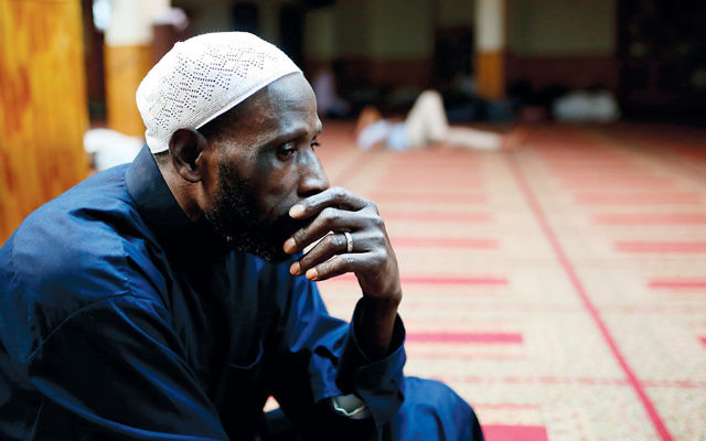 A Muslim man sits in the Alt Takwa Mosque in Brooklyn on June 20. (Mohammed Elshamy/Anadolu Agency/Getty Images)