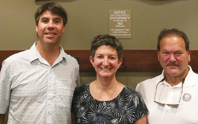 Whitefish's Mayor John Muhlfeld, at left, and Paul Goldenberg, the director of Secure Community Network, flank Rabbi Francine Green Roston.  (Courtesy Paul Goldenberg)