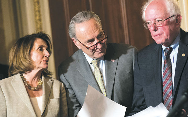 From left, Democratic leaders — House Minority Leader Nancy Pelosi, Senate Minority Leader Charles Schumer, and Sen. Bernie Sanders — stand at a Capitol Hill news conference on May 25, 2017. (Drew Angerer/Getty Images)