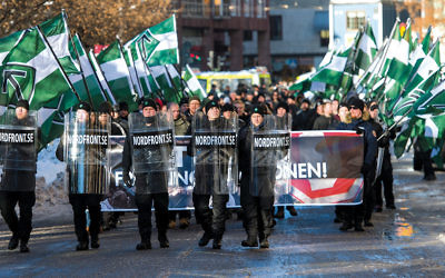 Nordic Resistance Movement sympathizers walk in an anti-immigrant demonstration in central Stockholm last November.  (Jonathan Nackstrand/AFP/Getty Images)