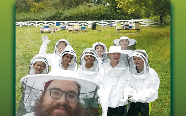 Rabbi Yosef Orenstein of Valley Chabad with some of the school's students. (Courtesy Chabad)