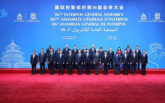 The leaders of the Interpol General Assembly posing at the Beijing National Convention Center, Sept. 26, 2017. (Lintao Zhang/Pool/Getty Images)
