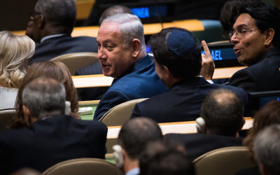 Israeli Prime Minister Benjamin Netanyahu taking his seat before President Donald Trump's speech to the General Assembly at U.N. headquarters in New York, Sept. 19, 2017. (Drew Angerer/Getty Images)