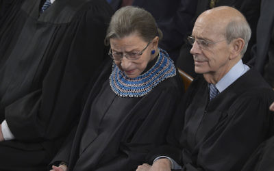 Supreme Court Justices Ruth Bader Ginsburg and Stephen Breyer listening to President Barack Obama deliver his State of the Union address before a joint session of Congress in the U.S. Capitol, Jan. 28, 2014. (Brendan Smialowski/AFP/Getty Images)